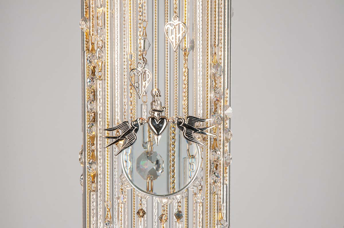 Close up of magnifying glass on the Celeste chandelier by Emerald Faerie. atmospheric lighting.