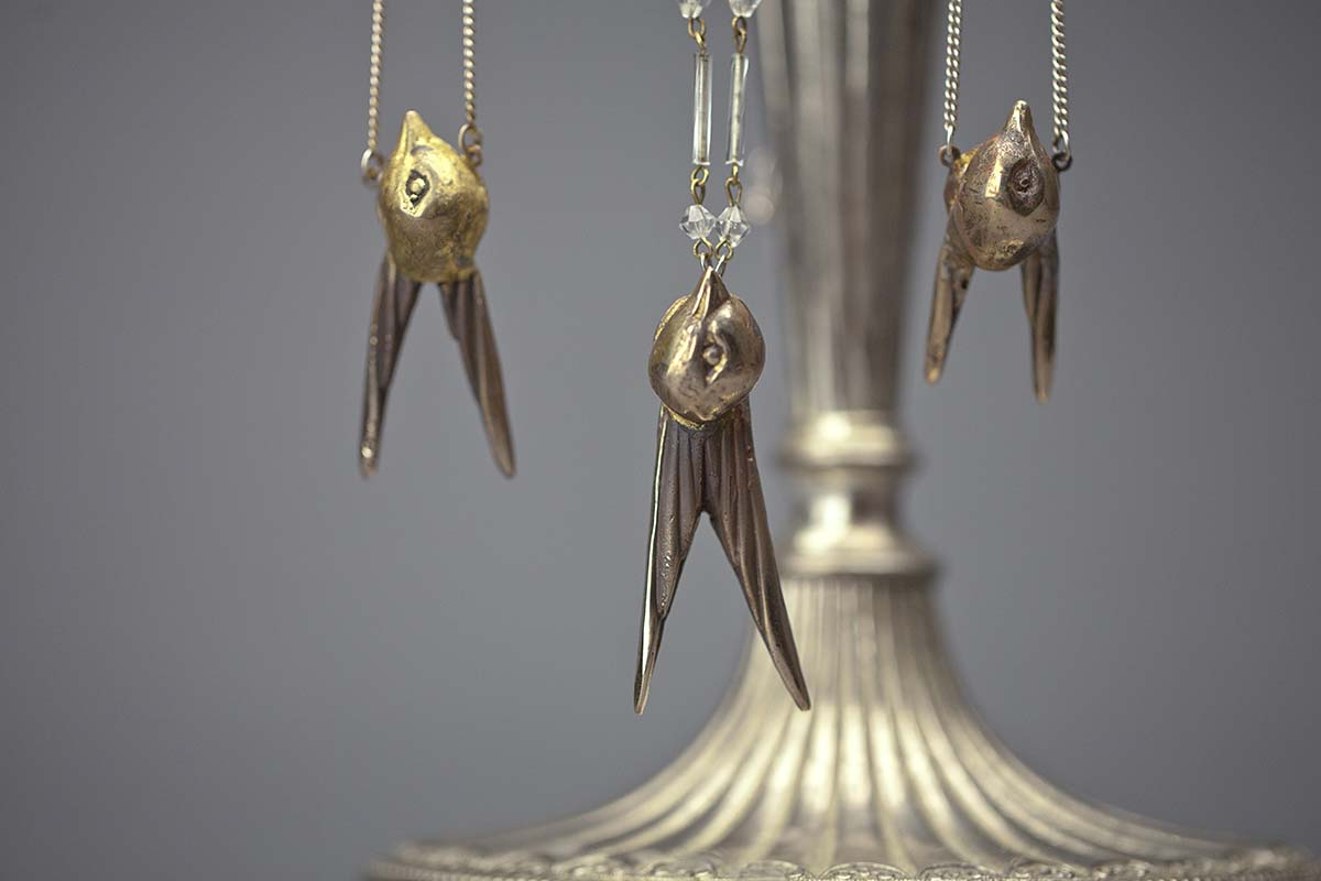 lifestyle shot of the Swift bronze necklace's.
