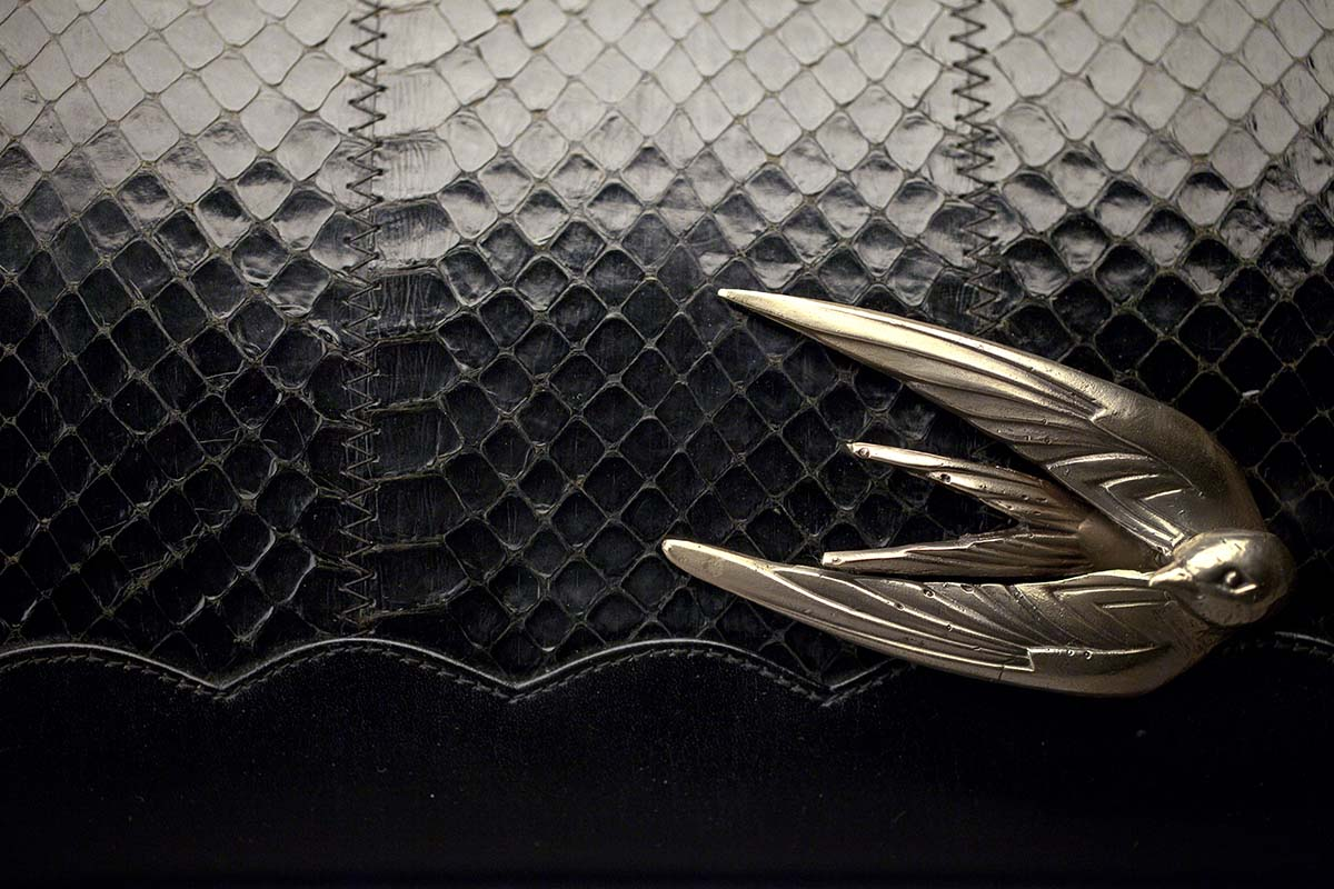 The Swift Clutch by Emerald Faerie. Recycled vintage handbags with solid bronze motif.