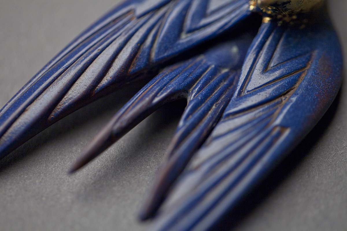 The Swift necklace by Emerald Faerie. With the Swift motif in bronze and resin.