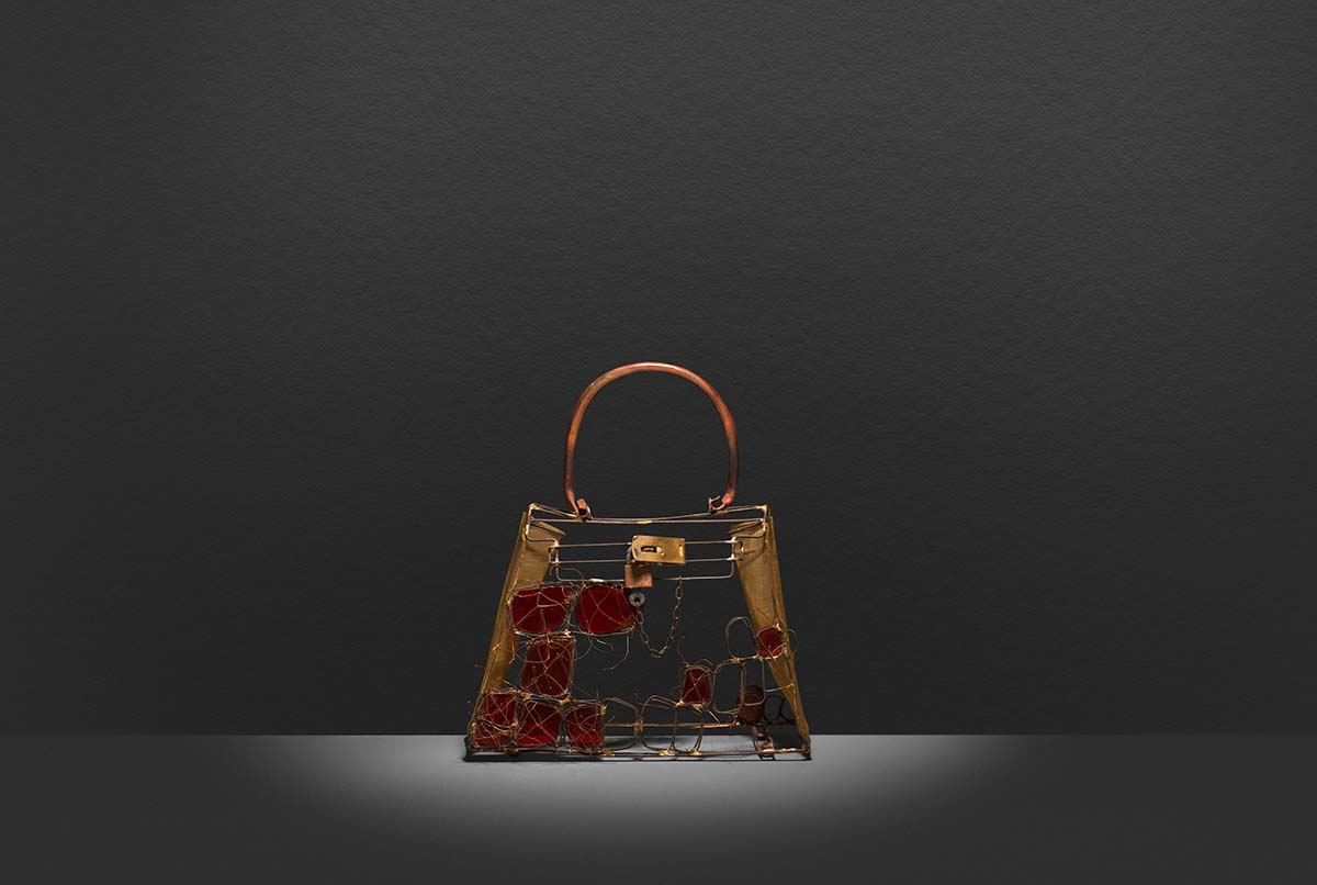 Wire and glass replica of the Crocodile finish of The Kelly an iconic Hermès handbag.