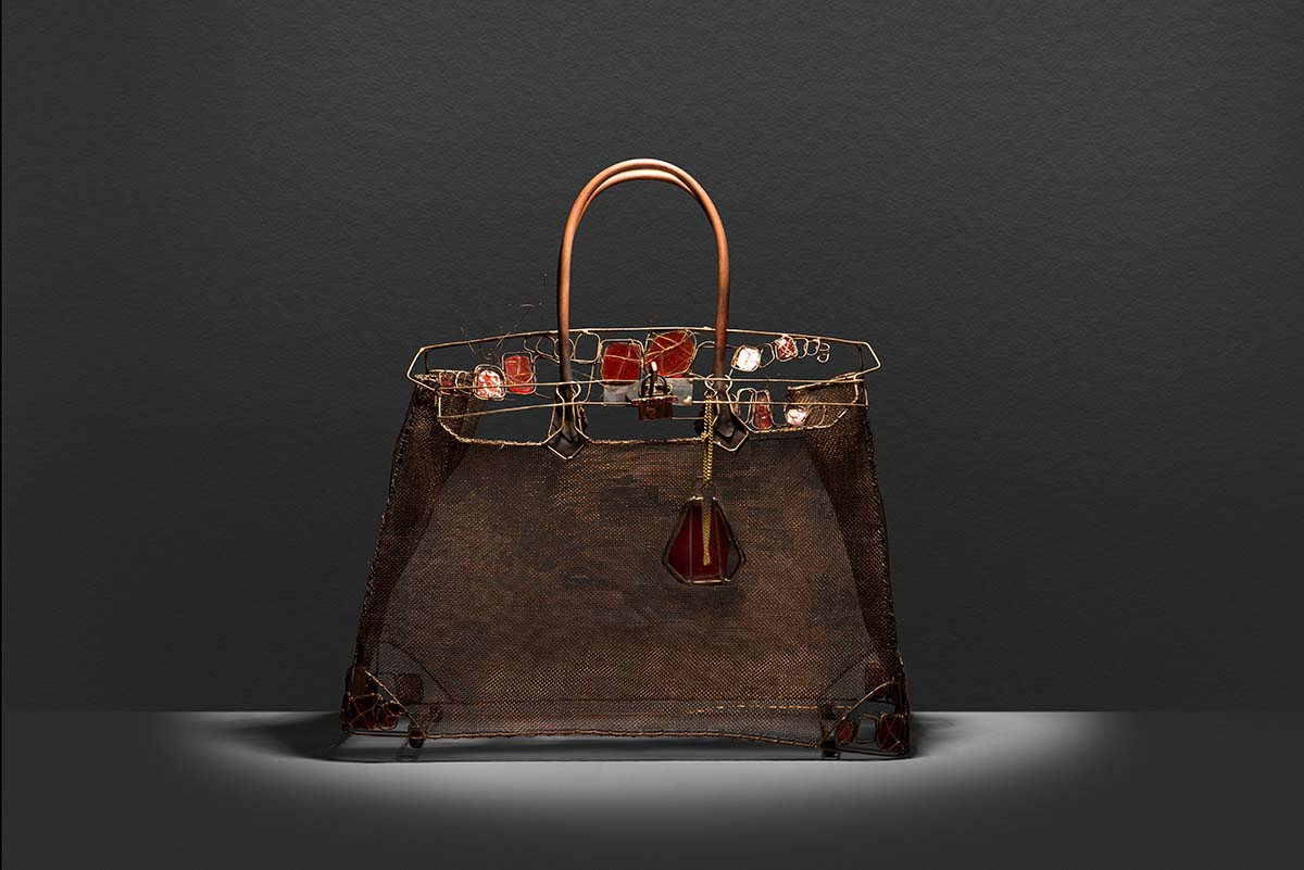 Wire and glass replica of the Crocodile and canvas finish of The Birkin an iconic Hermès handbag.
