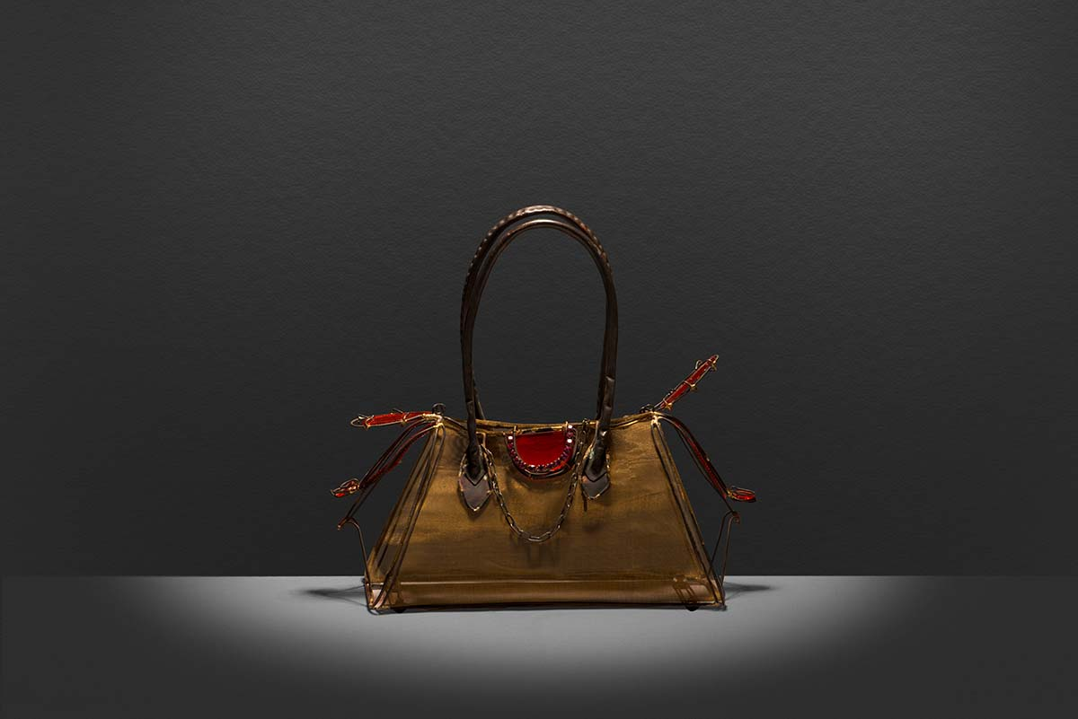 Mini wire and glass replica of the Crocodile and canvas finish of The Bombay an iconic Hermès handbag.