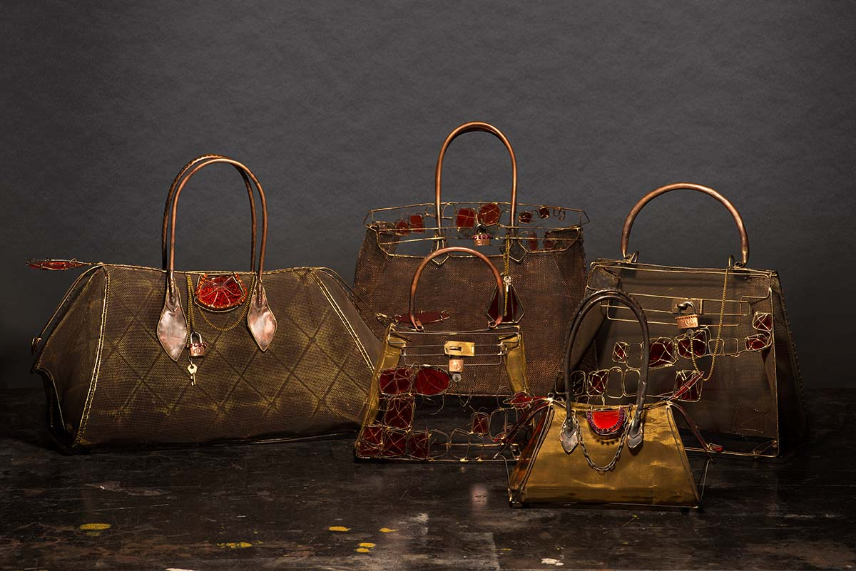 Life size wire and glass replicas of the most iconic Hermès handbags.