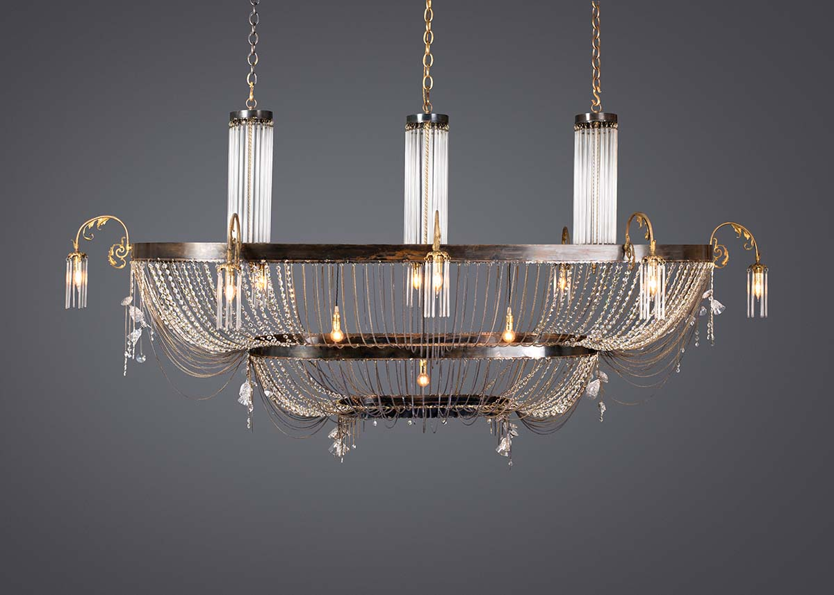 Ambrosia large oval chandelier. Custom made from Recycled materials and vintage cutlery. In an antique finish.