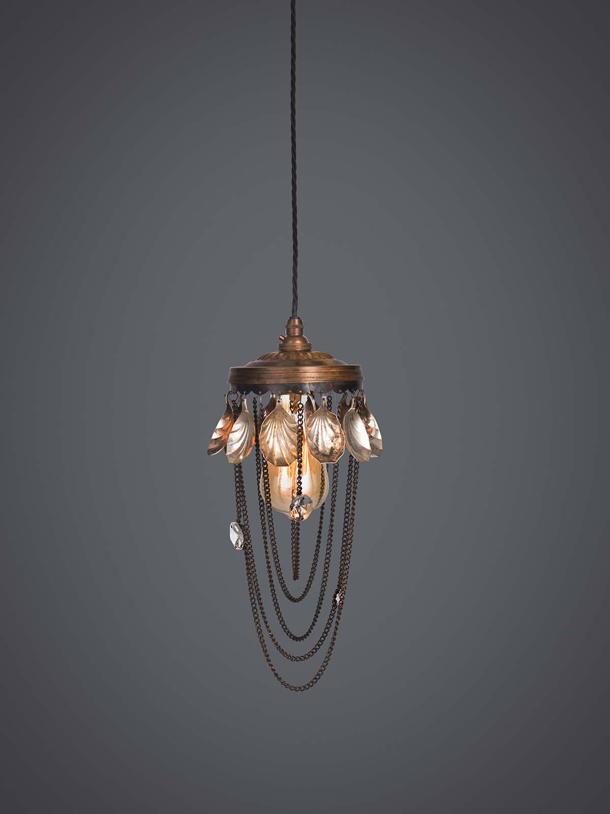 Ambrosia pendant lamp with fruit spoons.