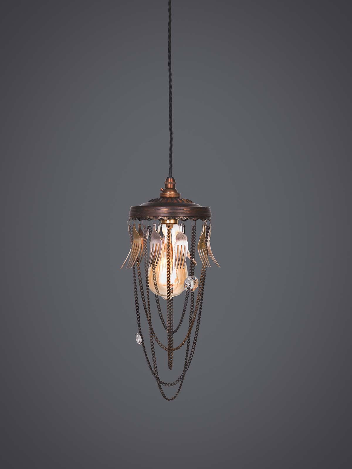 Ambrosia pendant lamp with recycled vintage forks.