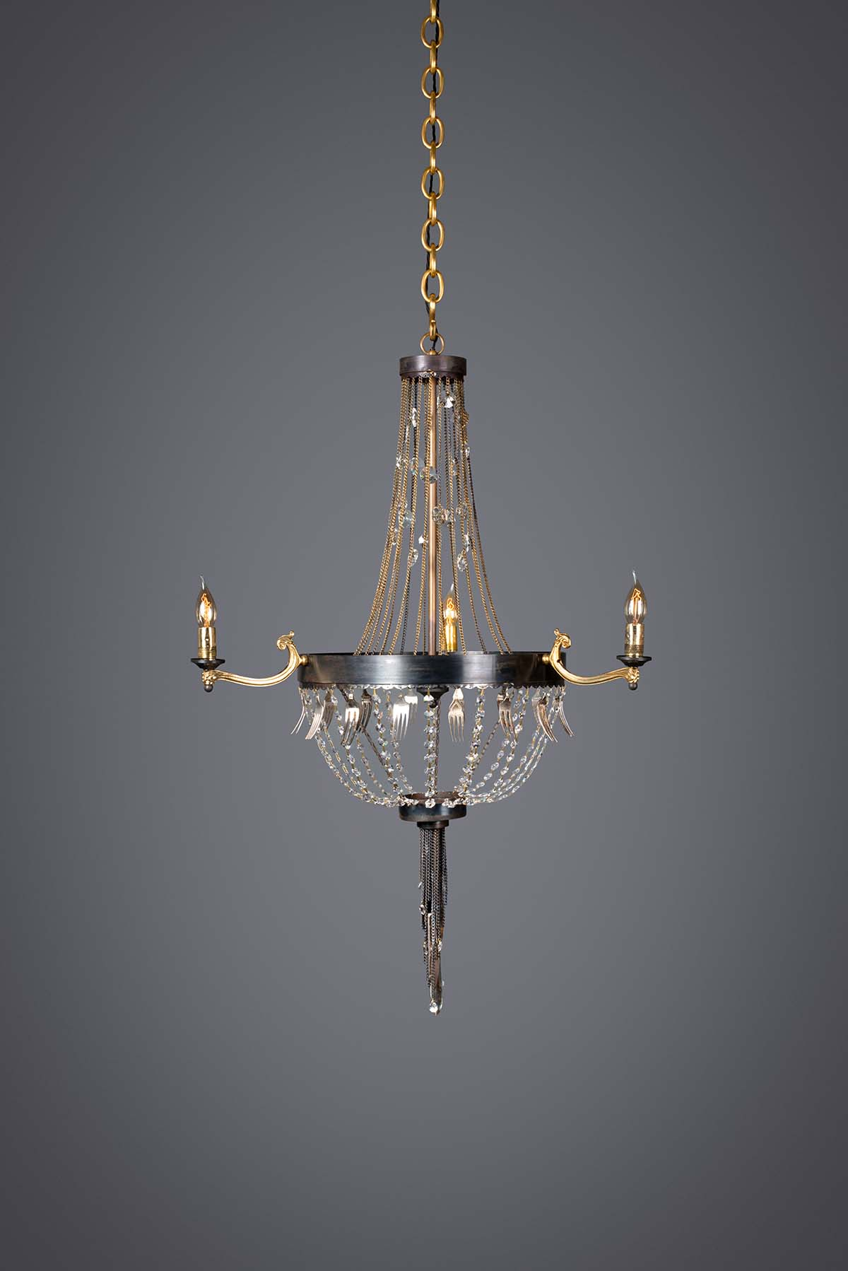 Ambrosia small chandelier made from Recycled materials and vintage cutlery. In an antique finish.