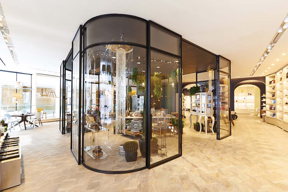 Glass house at the Lane Crawford store. with Cinderella's Revenge chandelier by Emerald Faerie.