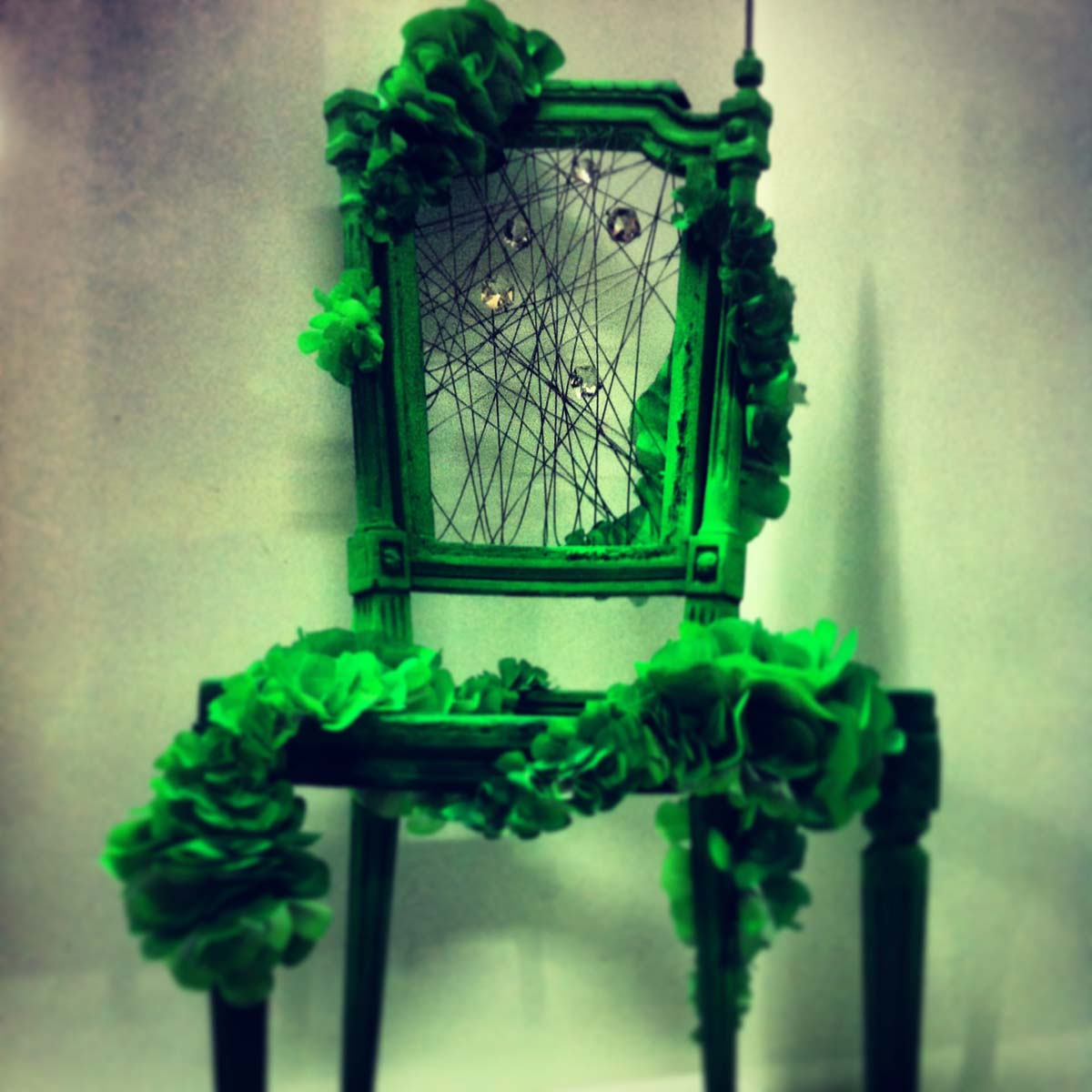 Green chairs made on site by Emerald Faerie at Lane Crawford in Hong Kong